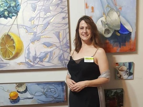 Artist Andie Freeman displays her paintings at a recent gala