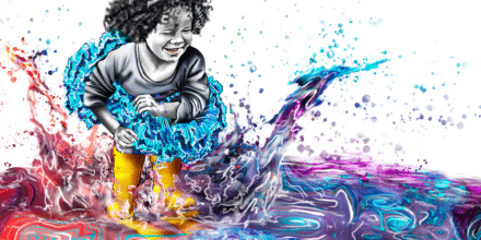 A little girl in a tutu jumps into a colorful puddle