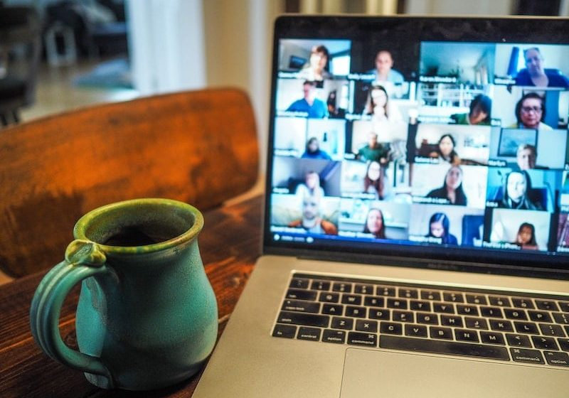 Networking on a video call from an artist's home office