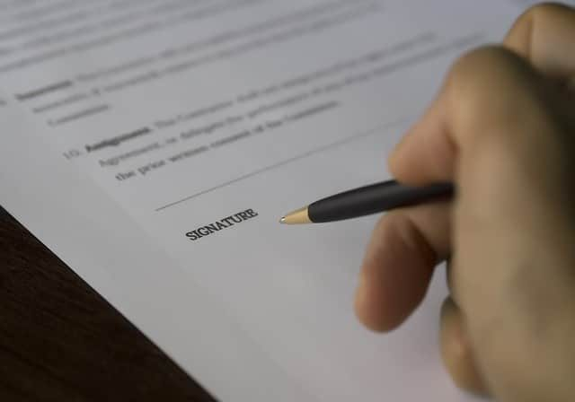 stock image of contract being signed